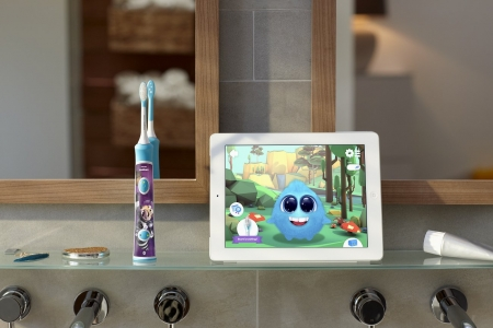 Phillips Sonicare for Kids toothbrush with app shown on tablet
