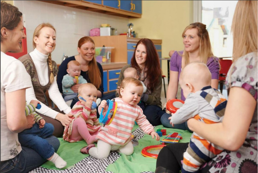 a group of moms and babies form a babysitting circle