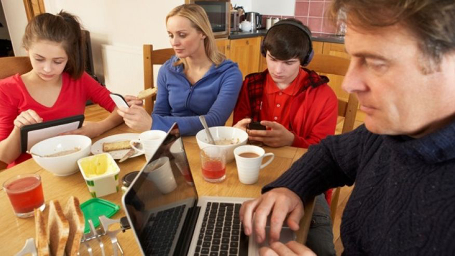 Family looking at devices not unplugged