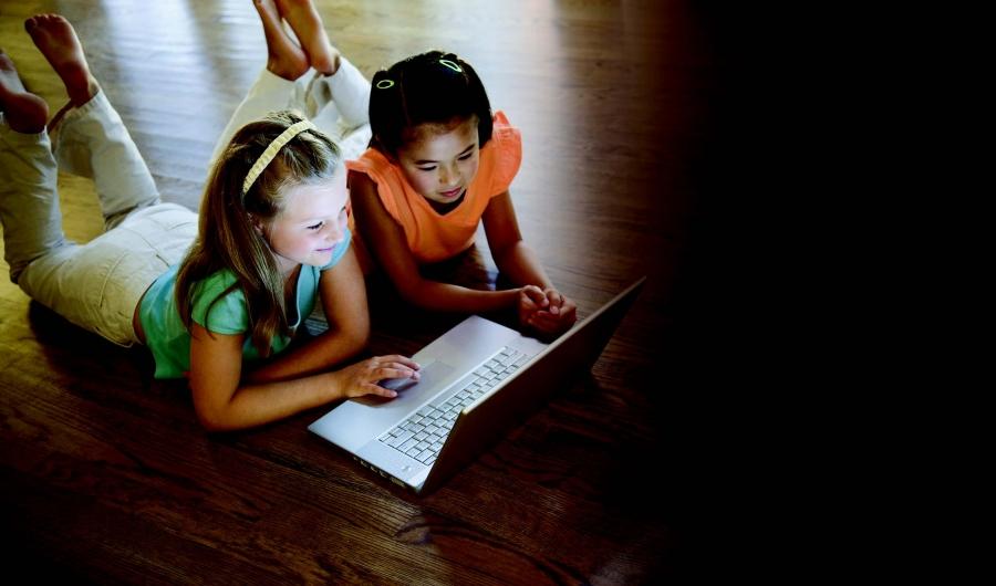 girls looking at a digital screen