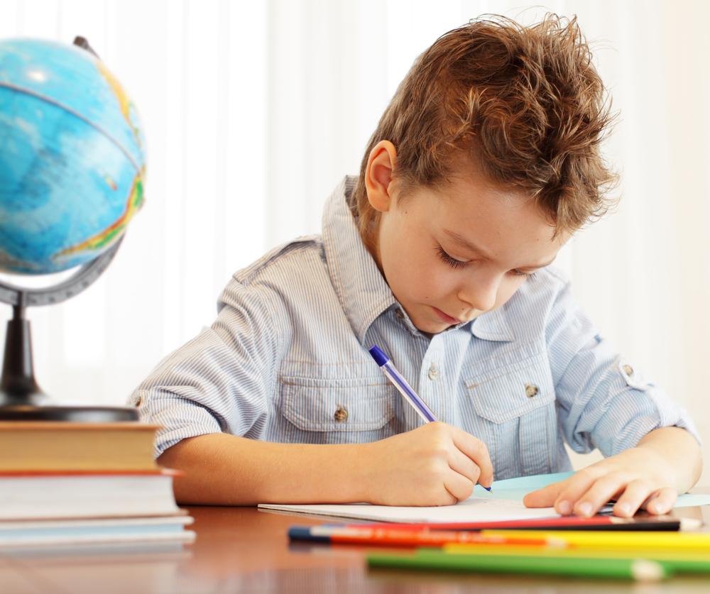 boy-doing-homework after psychological educational assessment