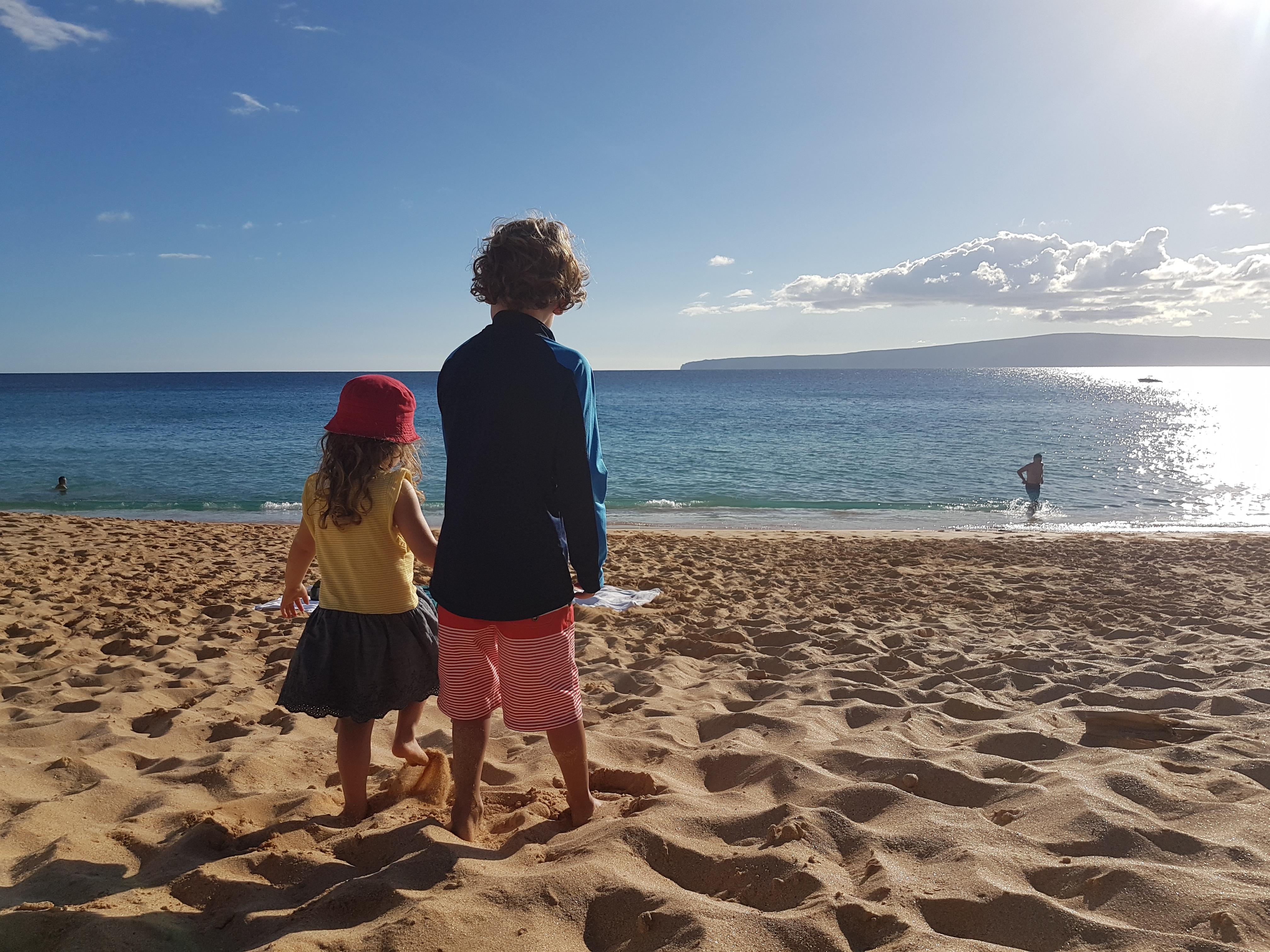 Kids looking at ocean in Maui