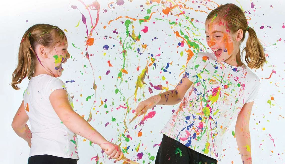girls playing with paint