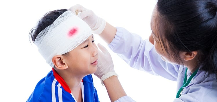 Sports Injury  Doctor Makes A Bandage On Head Patient, On