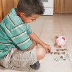 Boy counting money
