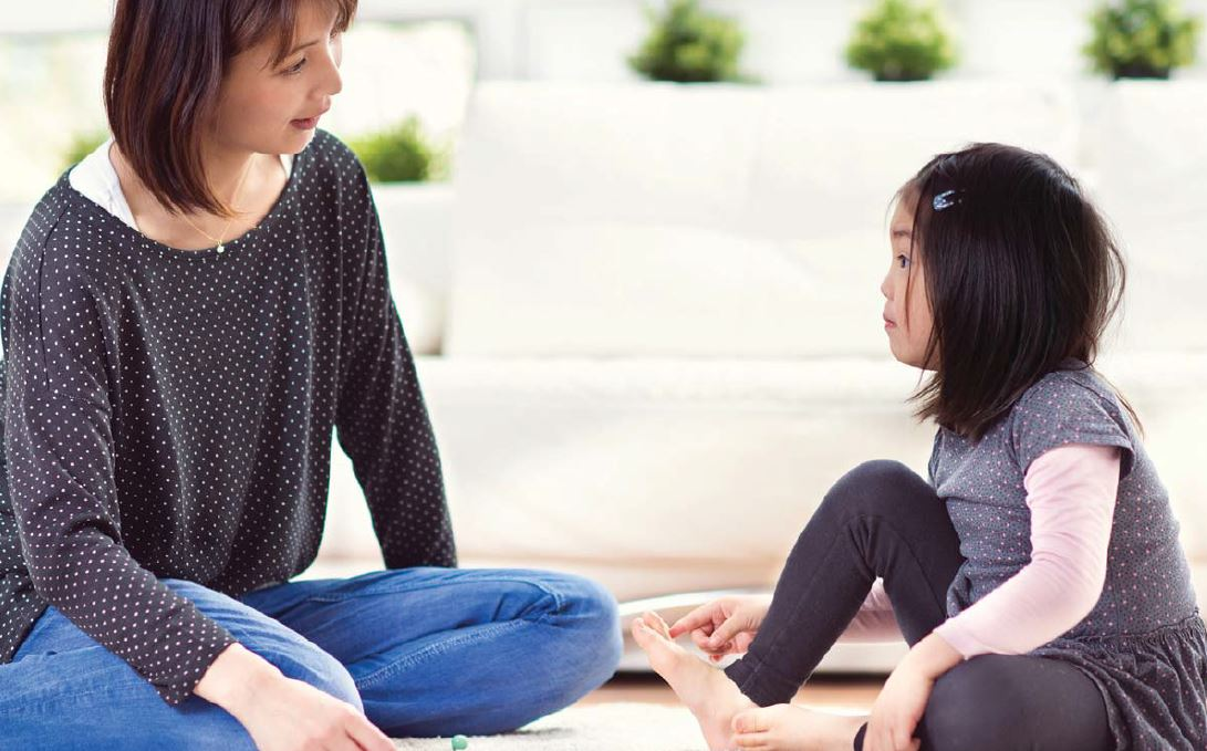 Mother talking to daughter about Post-Secondary
