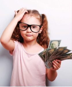 child holding money