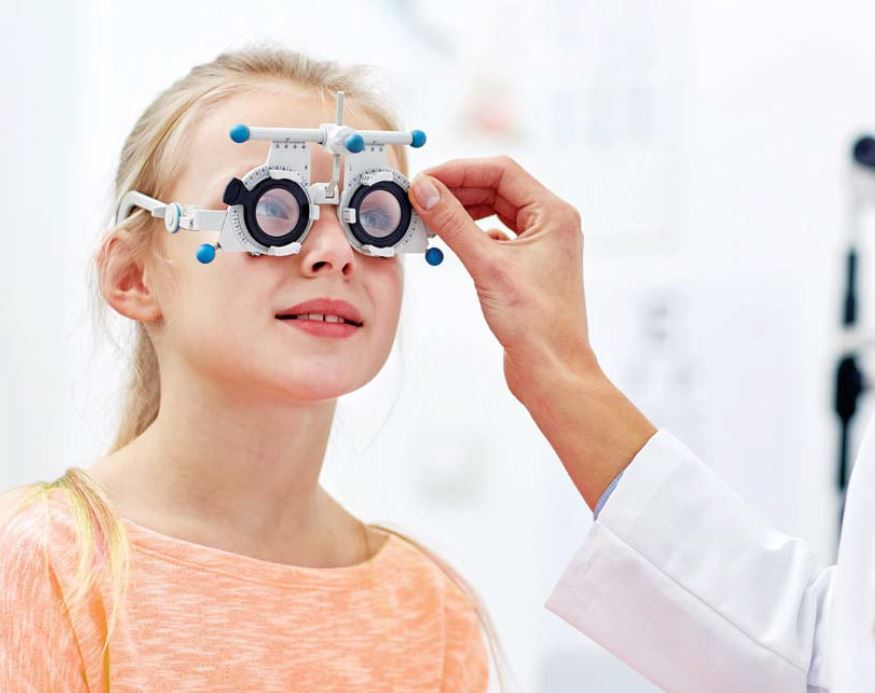 child getting eyes tested for myopia