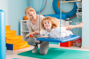 Occupational Therapist with boy