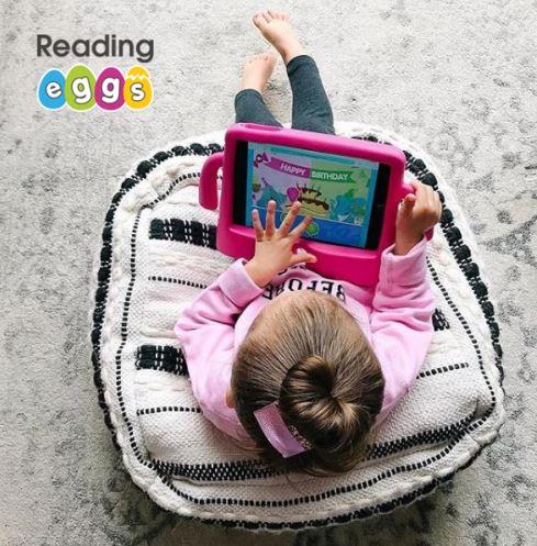 Girl using Reading Eggs