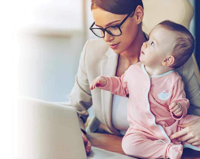 mom and baby with computer